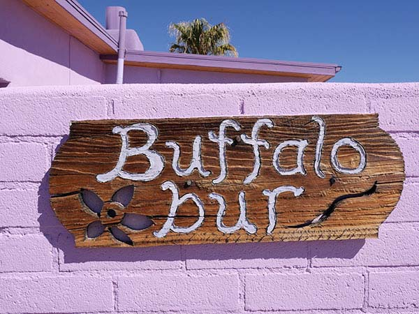 Hand carved Buffalo Burr Adobe sign