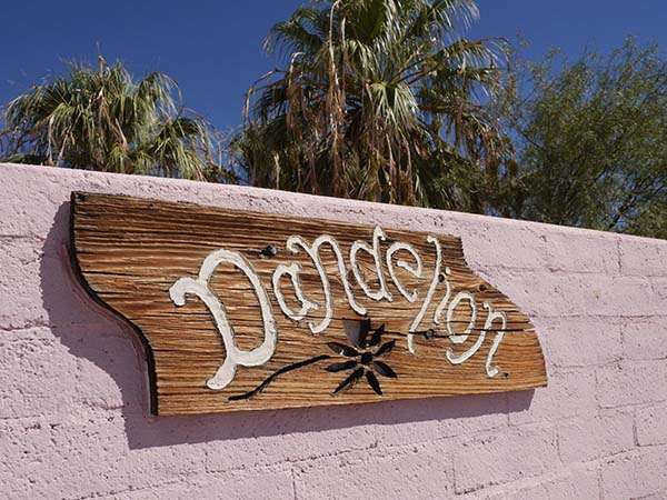 Hand carved Dandelion adobe sign