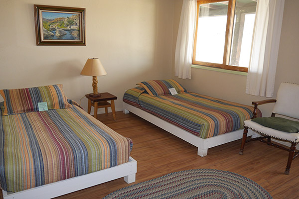 Main bedroom with two single beds MacKenzie Suite