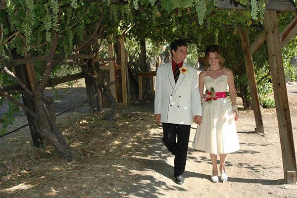 Bride & Groom walking through garden at 29 Palms Inn