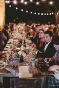 A long table full of people at a wedding