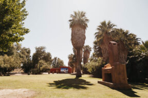 Photo of the scenery at 20 Palms Inn with an old fireplace in the background