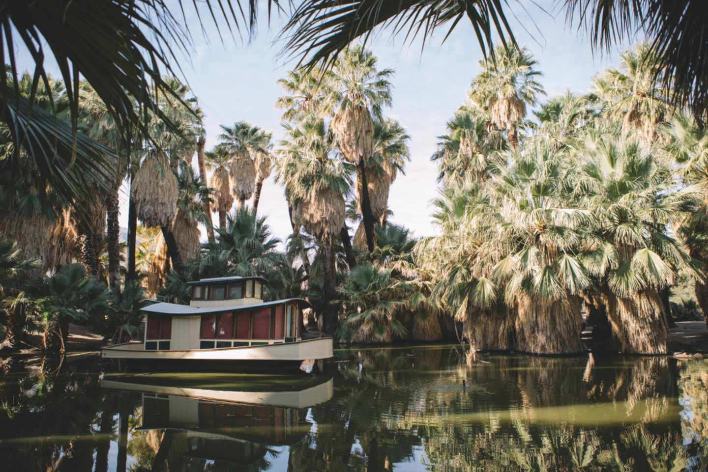 The Oasis of Mara, with a houseboat floating in the center