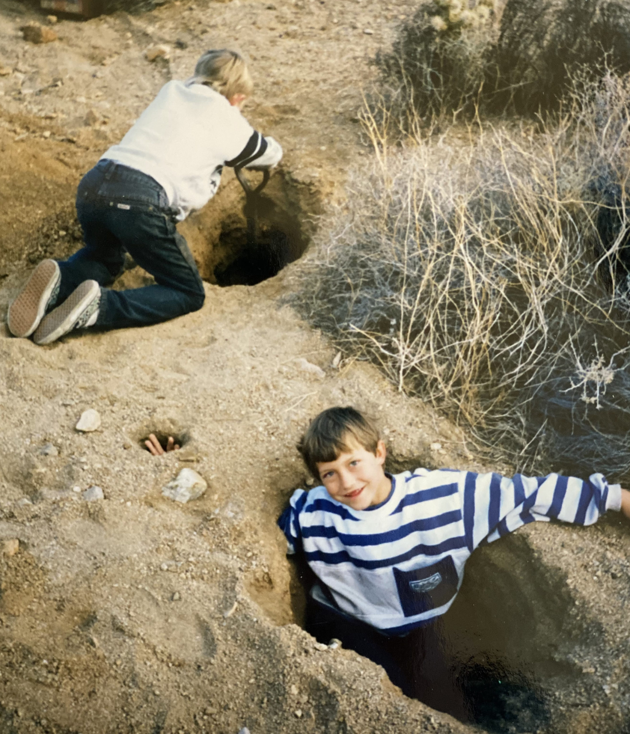 Cristian Grunt and friend digging holes in the desert
